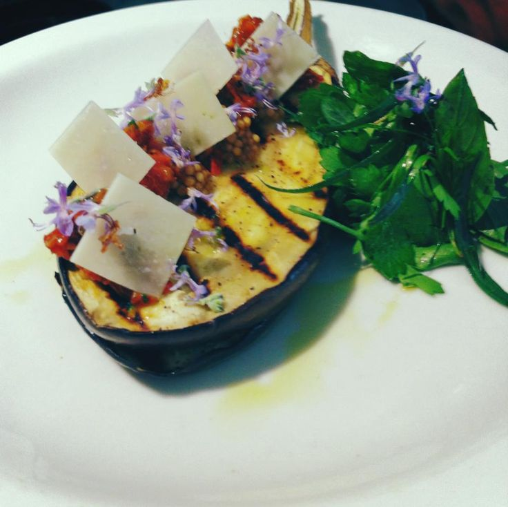 Grilled Eggplant, sun dried tomatoes, pickled mustard seeds, pecorino, rosemary flowers