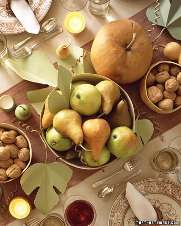 A Harvest Table  Set a celebratory table with bold splashes of color from the garden or farmers' market; gourds, fruit, and nuts come in golds, yellows, oranges, and a range of browns and greens.