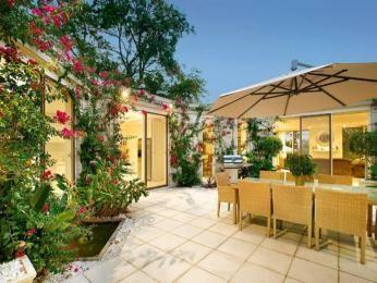 Indoor-outdoor outdoor living design with bbq area & decorative lighting using tiles - Outdoor Living Photo 461697