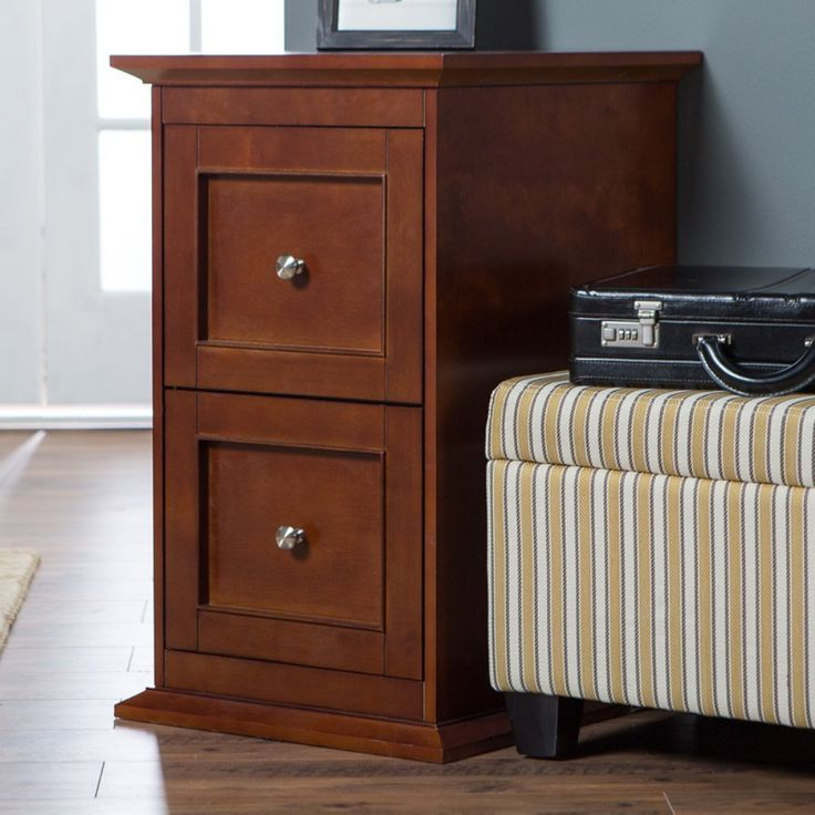 Belham Living Hampton Two Drawer Wood File Cabinet. Dimensions: 19L x 21W x 31H in. Solid wood frame with oak veneers. Warm cherry finish. Versatile transitional style.