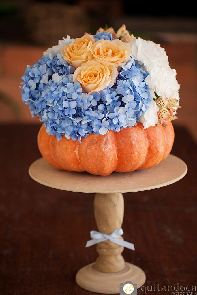 Cinderella party centerpiece: (Silver Pumpkin, w/pink white and blue flowers)