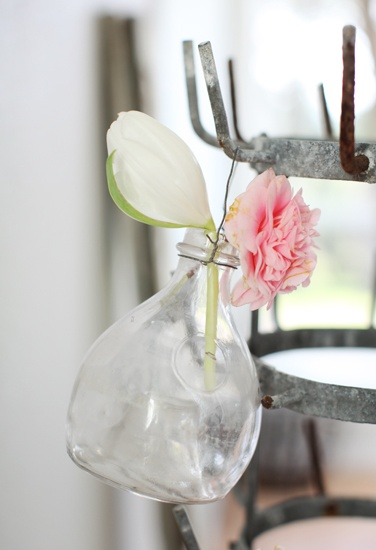 dreamy whites wine bottle rack used for flower vases