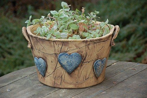 Raised decorations on a clay plant pot