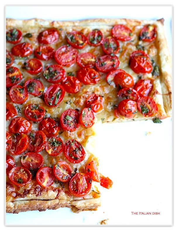 Cherry Tomato Puff Pastry Tart: 1 pt. cherry tomatoes, oil, s, basil, oregano, 1Tb horseradish mustard, 1/3c mozz, 1/3c gruyere, 1/3c parm. Thaw 1 sheet puff pastry.  400* oven. dock pastry w fork.  Spread mustard on dough then cheese and top with tomatoes.++Cut side of tomatoes must be facing up to prevent soggy dough. Bake 15-20 min.