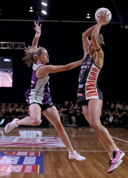 Kim Ravaillion of the Magpies is pressured by Erin Burger of the Firebirds during the round 10 Super Netball match between the Magpies and the Firebirds at the Silverdome on April 30, 2017 in Launceston, Australia.