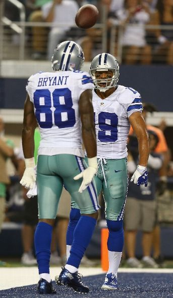 Miles Austin #19 of the Dallas Cowboys celebrates with Dez Bryant #88 of the Dallas Cowboys after scoring a touchdown against the Cincinnati Bengals in the second quarter during a preseason game at AT Stadium on August 24, 2013 in Arlington, Texas. (Photo by Tom Pennington/Getty Images)