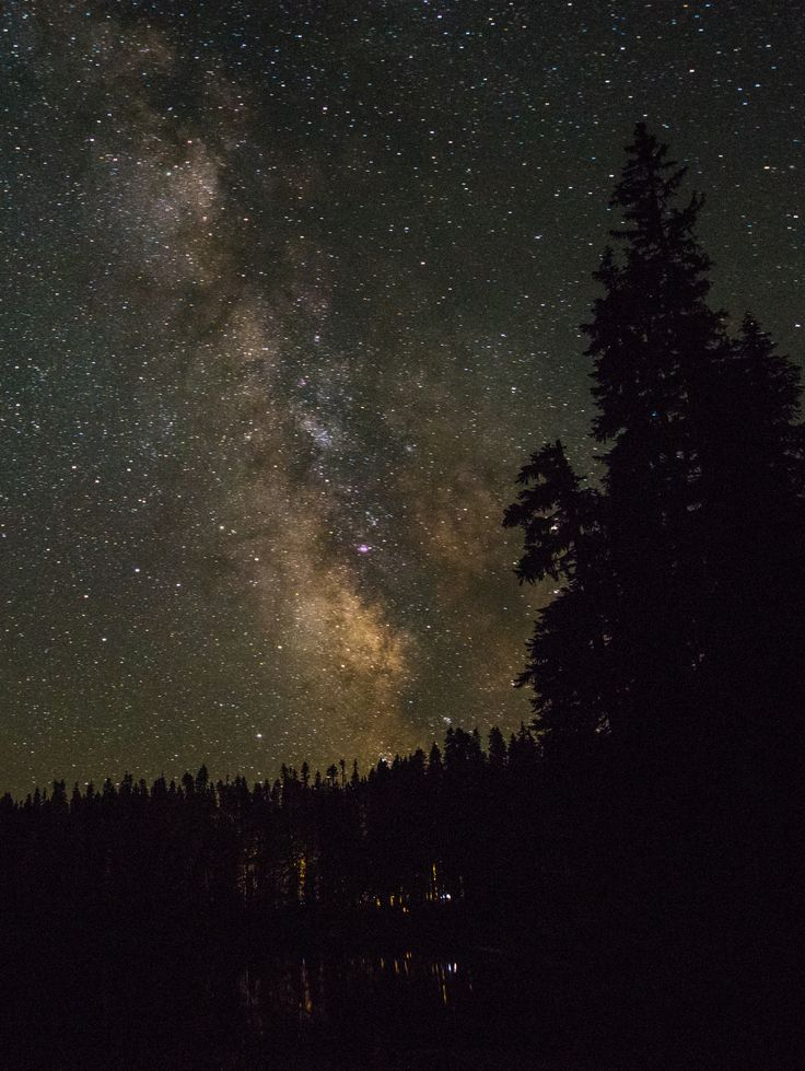 Humans and their galaxy speak one language as the dim light from a campfire reaches for the pillar of stars that is the Milky Way. This was shot at Lake Takhlakh, to the Northwest of Mount Adams. ⠀ ⠀ Date: July 22, 2017; Focal length: 24mm; Exposure: 30 seconds; Aperture: f5; ISO: 4000; Mount: Untracked; Camera body: Nikon D810; Lens: 12-24mm Tokina⠀  http://trib.al/G4BOvD2