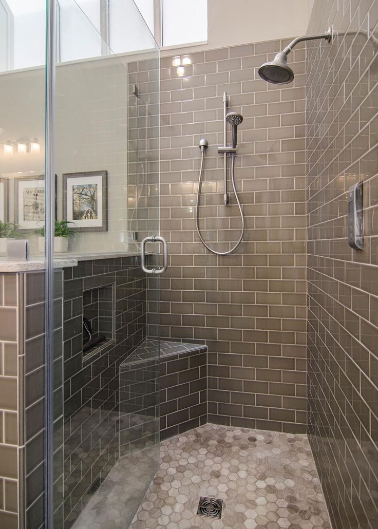 The back splash in the Haires' master bathroom adds a focal point to the neutral colored tile in this space. More