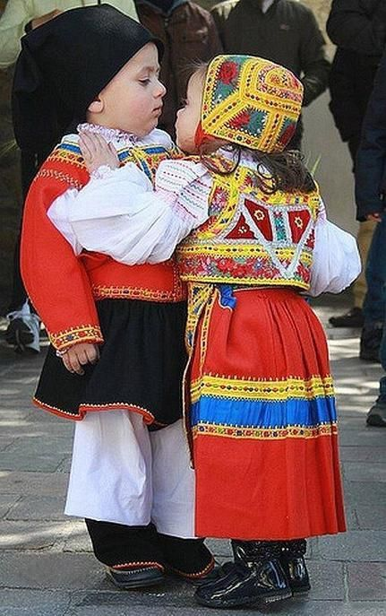 A pair of cutie pies in traditional Sardinian costumes <3