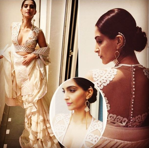 Sonam Kapoor takes Cannes by storm in Abu Jani Sandeep Khosla! The supremely stunning diva wore a light beige, chiffon layered frill saree edged with chamoise appliqué borders teamed with a skin net HEARTS blouse.