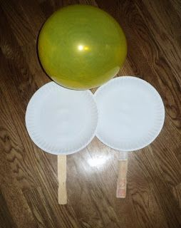 Grab some balloons, paint stir sticks, tape and paper plates and play some balloon volleyball with the grandkids