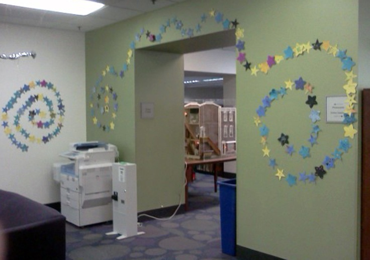 Create a night sky with construction-paper stars. Westerville Public Library's 2012 Summer Reading Program asked participants to help them decorate their walls with stars to represent the hours that they read throughout the summer. #interaction #interactive #participation #group #activity #cheap #easy