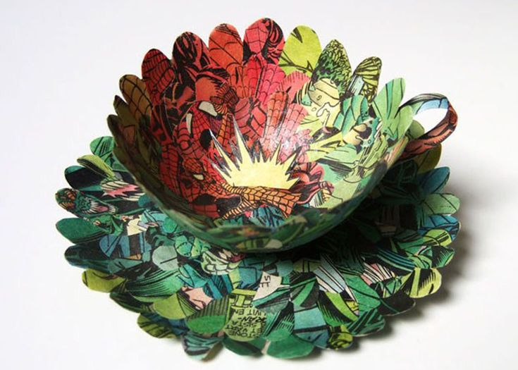 Old books are carefully cut up into pieces and reassembled into new, delicate forms.