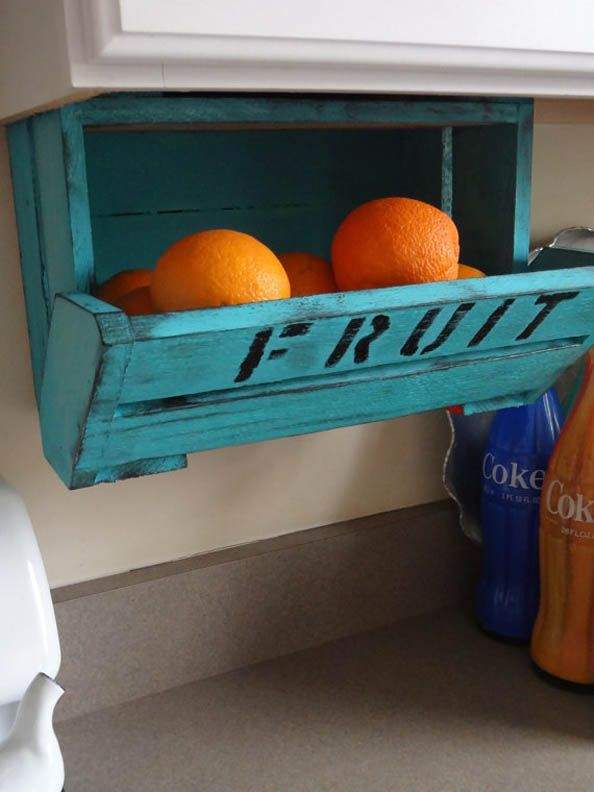 Under Counter Fruit Bin ~ THIS is a real cool idea for kitchen storage (for other home organizing too). Could be an easy DIY project with the Clementine crates (that holds those cute mini oranges!) from the grocery store. Paint to match your kitchen decor and free up some counter space!