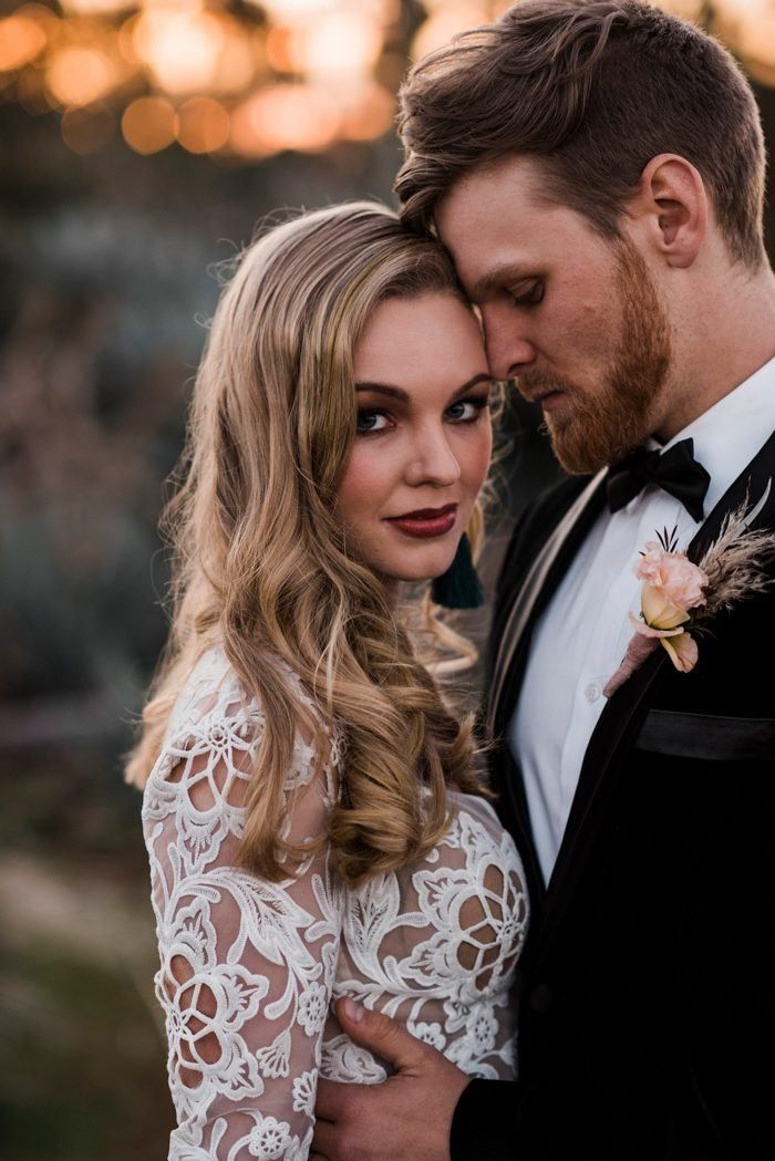 A blushing bridal makeup look featuring a metallic red lip | Image by Immerse Photography  #desert #desertwedding #wedding #weddinginspiration #weddinginspo #fallwedding #springwedding #summerwedding #pinkwedding #boho #bohemian #bohowedding #bohemianwedding #modernwedding #bridalfashion #bridalinspiration #bride #groom #groominspiration #groomstyle