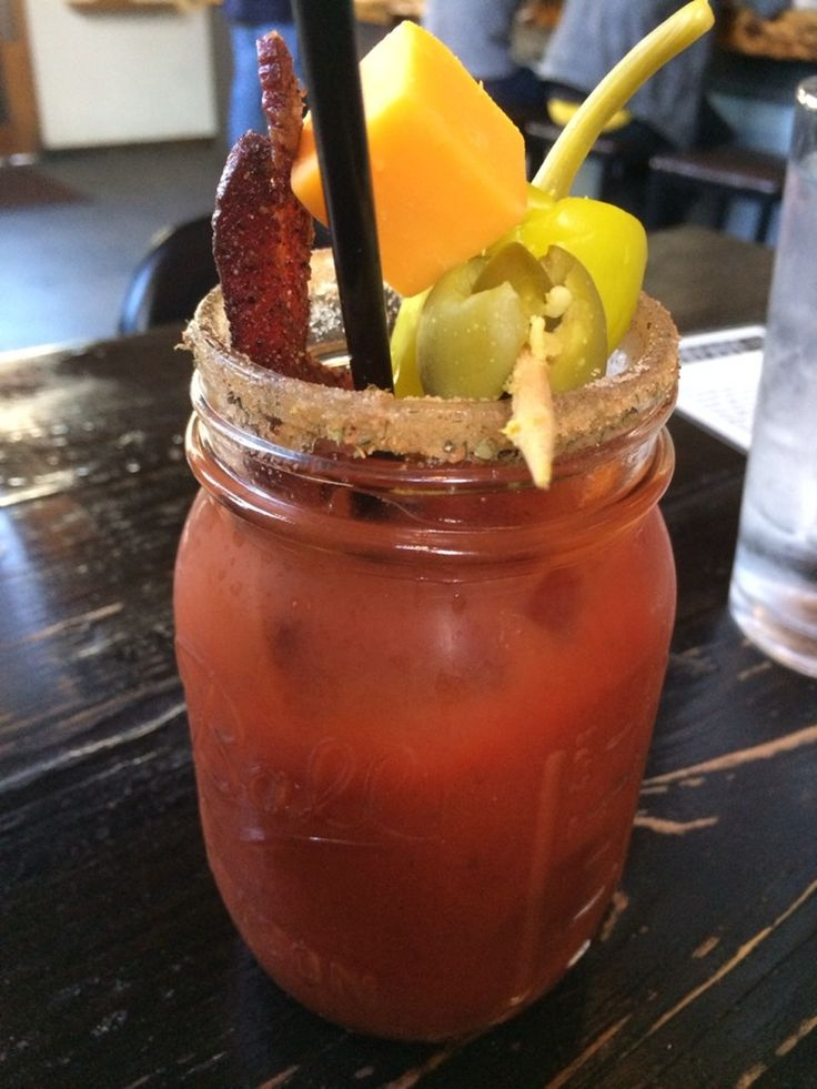 Bloody Mary made with bacon-infused Tito's vodka, & garnished with bacon, cheddar cheese, a jalapeno stuffed olive, and pepperoncini. Frank Restaurant, Austin.    Photo by John K.