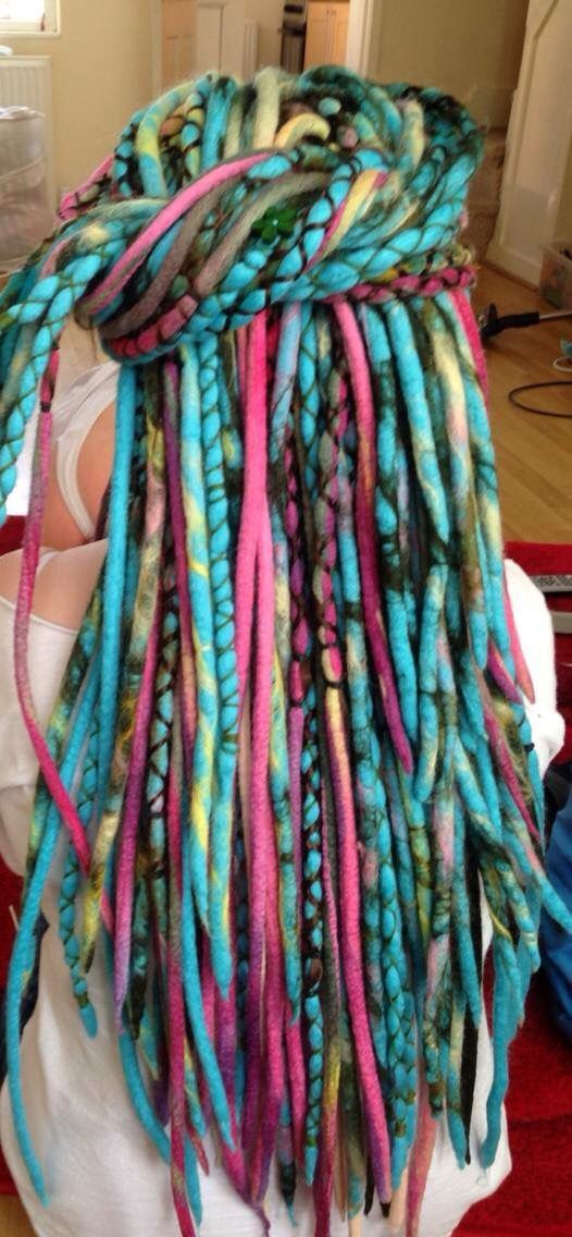 """Blue lagoon"" wool dreadlocks.. These are a combination of marbled and plain base colours with mixed colours together! Made my mee! I have wrapped and sewn some buttons and jazz in!"