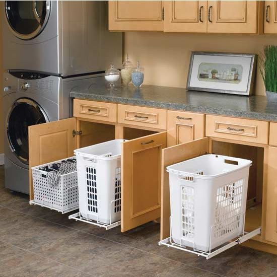 Install pull-out hampers in a bathroom or laundry room. | 42 Storage Ideas That Will Organize Your Entire House
