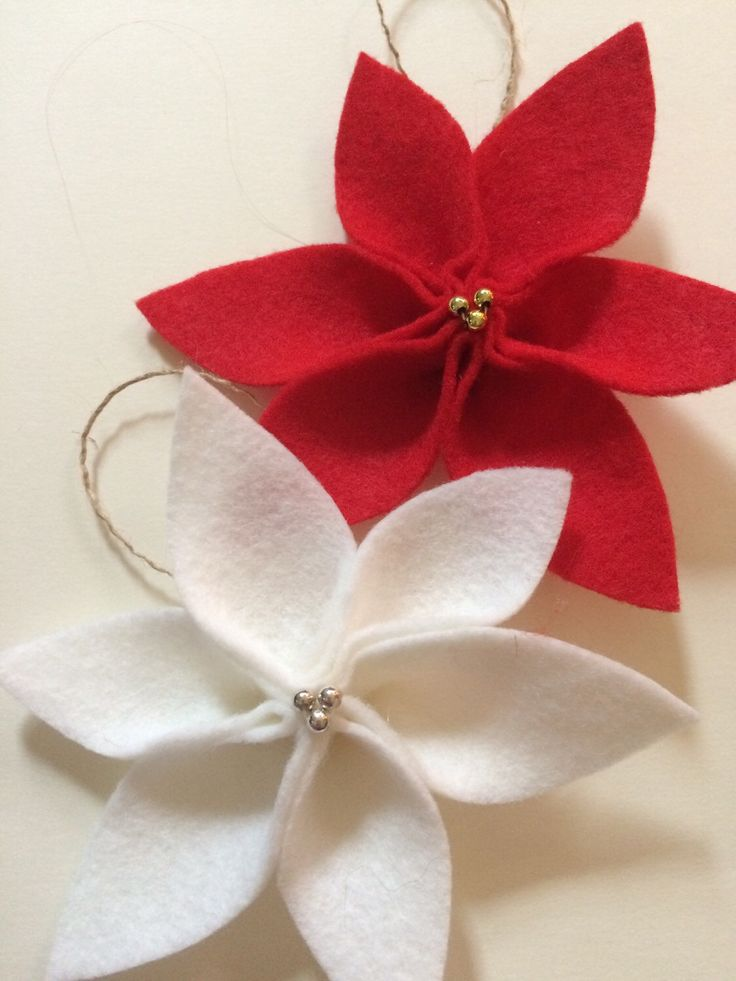 A personal favorite from my Etsy shop https://www.etsy.com/listing/258866599/felt-christmas-ornaments-felt-poinsettia