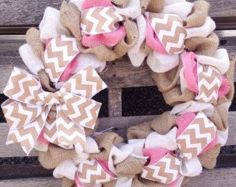 This is the perfect everyday wreath. The natural burlap is a classic paired with the popular gray and white chevron. The red and white ribbon is a fun trendy touch!  Need to add a personalized monogram?. Please convo us for details before placing your order. Additional pricing will apply.  Wreath is not intended for direct sunlight. Preferably hung under covered porch. If you intend to display it outside, let us know and we can spray it with UV protection. All wreaths are handmade and will…