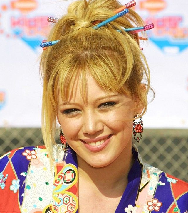 Hillary Duff's chopstick adorned bun is the epitome of early-2000s beauty trends