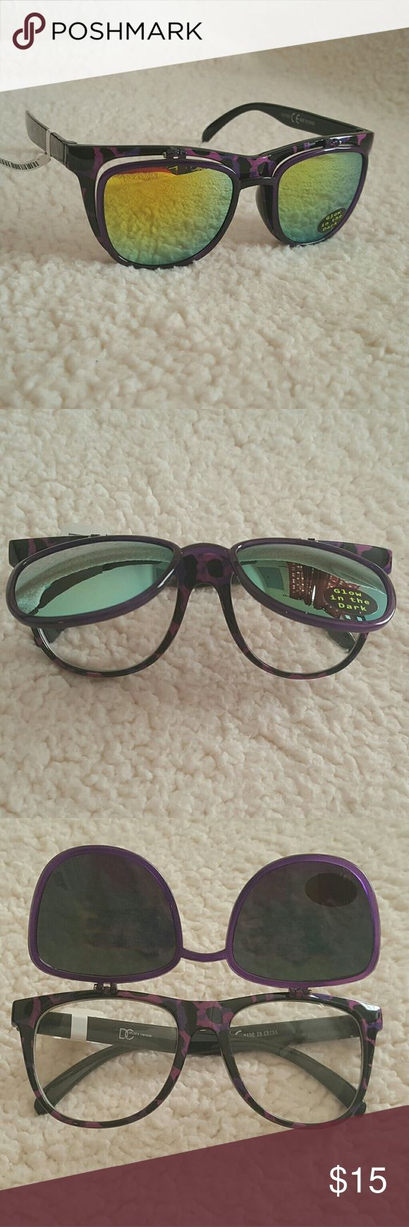 NEW Purple Leopard Sunglasses These awesome pair of sunglasses feature flip lenses! They are a purple leopard pattern with yellow reflecting tint. Flip them up to reveal clear shades! They also glow in the dark. These make for a great pair of party shades! Bought at Hot Topic. Brand new with tags.  **Take a peek at my other listings. Bundle for extra savings! Thanks for looking!**  --------------- Summer Spring Sunnies Reflectors Hot Topic Accessories Sunglasses