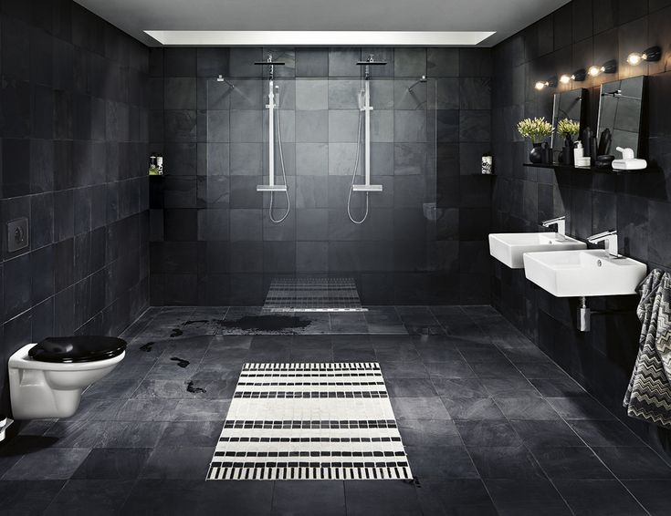 black tile bathroom photo by alexander crispin