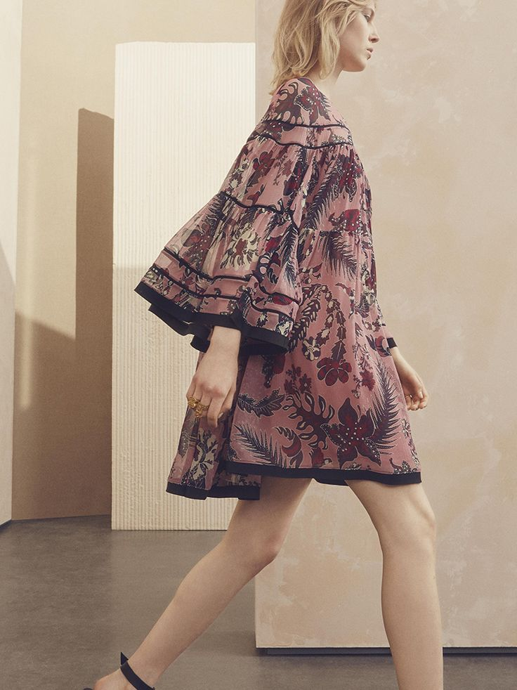 The romance of flou – in pink and plum-printed silk crepon, this bell-sleeved dress will take you into the new season
