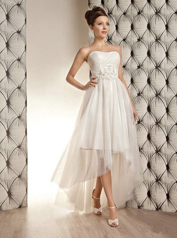 - A line - Lace detail with beading and crystal embellishment - Button down back - Sweetheart neckline - Floor length - Chapel train