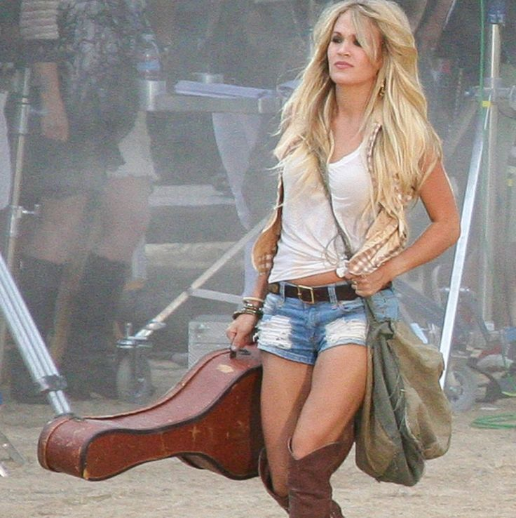 Carrie Underwood is one hot mama in a pair of Daisy Dukes while on the set of her latest music video!   toofab.com