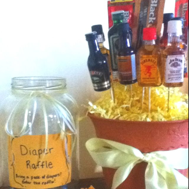 Diaper party raffle... coed, can do one basket for the guys like this, and a girly one for the girls!