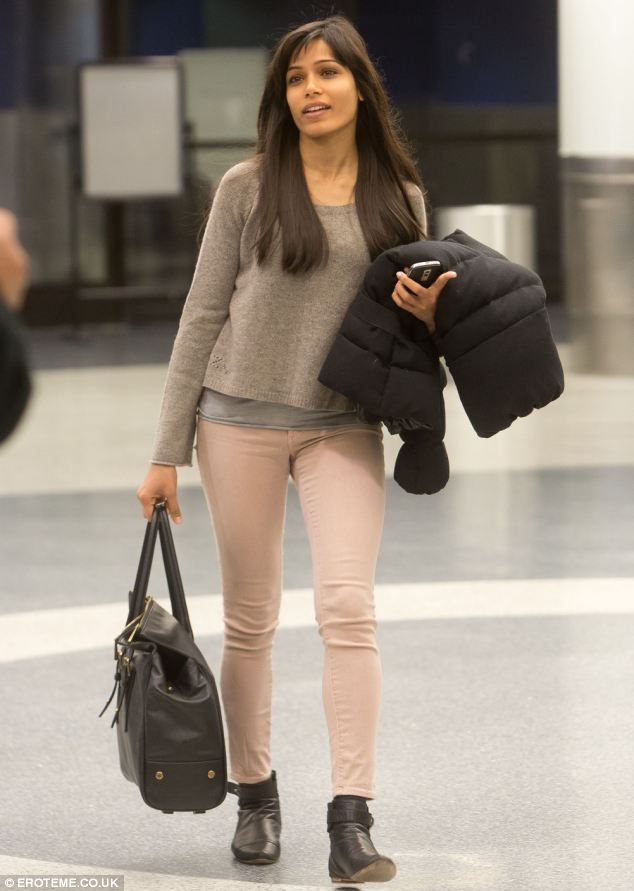 Stunning: Actress Freida Pinto touches down in LA after a stint at the Sundance Film Festival in Utah