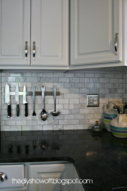 Beautiful backsplash. Creates a great transition between the dark countertops and the white cabinets.