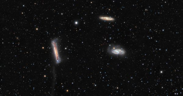 A mere 30 million light-years away large spiral galaxy NGC 3628 (center left) shares its neighborhood in the local Universe with two other large spirals in a magnificent grouping otherwise known as the Leo Triplet. In fact fellow trio member M65 is near the center right edge of this deep cosmic group portrait with M66 just above it and to the left. #astronomy #space