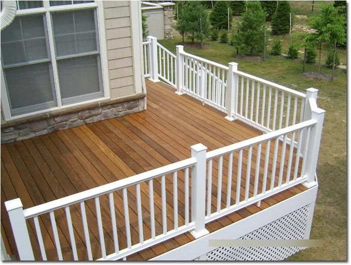 Composite Deck with Railing See many Deck Railing Ideas http://awoodrailing.com/2014/11/16/100s-of-deck-railing-ideas-designs/
