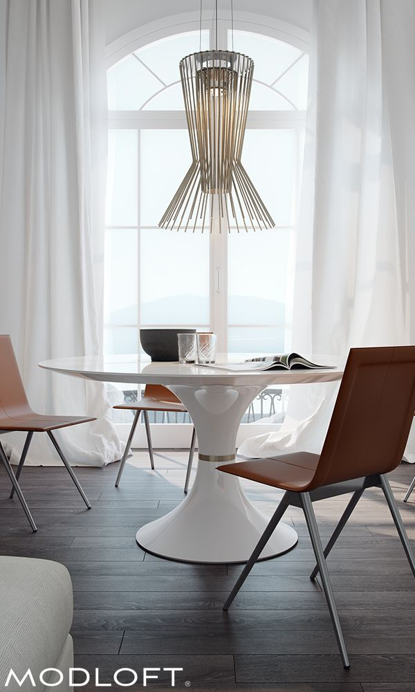The thin white glass top of the Waterloo Table drips into a tulip-shaped base finished in a high gloss white lacquer. The seamless snowscape is interrupted only by the brass band at the pedestal's narrowest point. Available in Quick-Ship program.