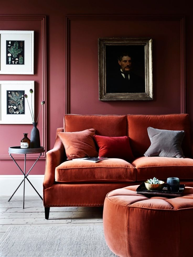 Up the cool factor in a big way by mixing rust-colored velvet furniture with plum walls.