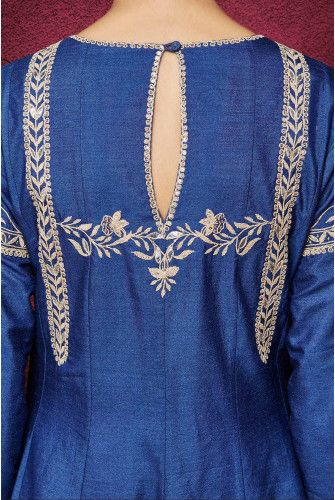 A monga silk blue kurta with exquisite gota patti and resham embroidery with sequin detailing, paired with a chanderi silk blue churidaar and a modal silk dupatta. An elegant anarkali suit, ideal for a light pre-wedding occasion look. Complete the ensemble with golden mojris, chaand balis and a statement jadau ring.