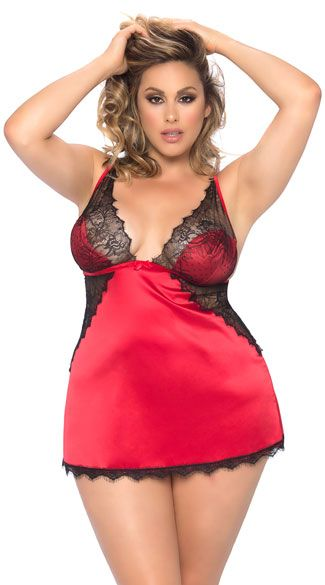Cozy up with your sweetie in this romantic plus size satin chemise featuring triangle cups with a black eyelash lace overlay, adjustable spaghetti straps, a satin bow accent, an adjustable back strap, an open back panel, sheer black lace panels, a lace trim, and a matching panty. Plus Size Sidonie Satin and Eyelash Lace Chemise Set, Plus Size Satin and Lace Chemise Set, Plus Size Satin Chemise Set #plussizelingerie #plussizevalentinesdaylingerie #plussizechemises