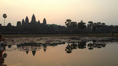 Reflections - Sunset Stages Over Angkor Wat http://jouljet.blogspot.com/2013/02/sunrise-stages-over-angkor-wat.html #Cambodia #travel #temples