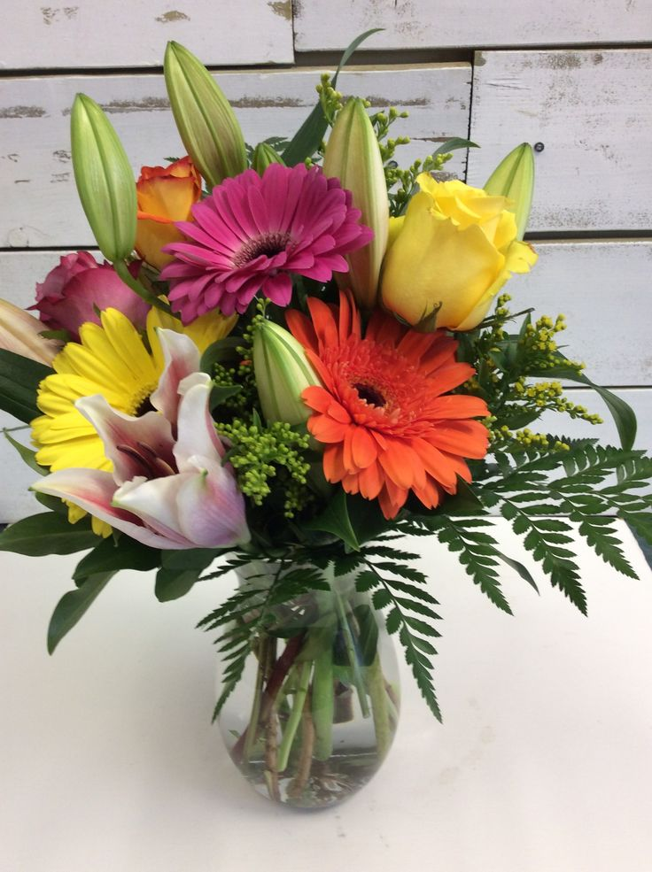 Complimenting roses and gerbras with stargazer lilies create an elegant look.
