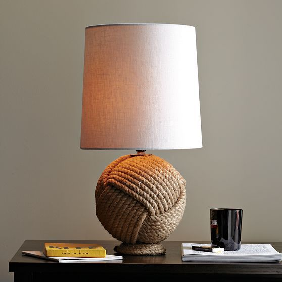 could it be as as simple as finding a thrift shop ball lamp w/hot glue-d rope?