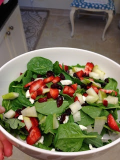 spinach salad with apples, pears, strawberries, and craisins..covered in trader joe's champagne pear vinaigrette dressing. favorite summer salad!
