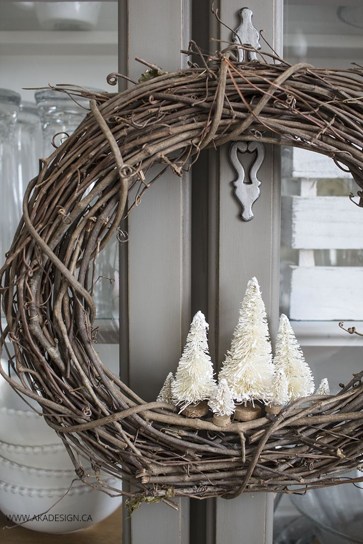 Make your own VERY simple rustic holiday wreath with a grapevine wreath and a few bottle brush trees!