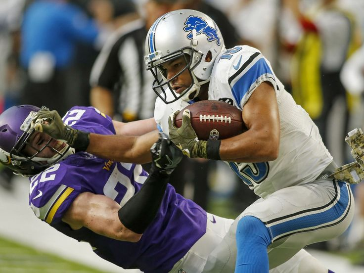 Lions vs. Vikings:  22-16, Lions  -  November 6, 2016  -     Nov 6, 2016; Minneapolis, MN, USA; Lions receiver Golden Tate stiff-arms Vikings safety Harrison Smith and scores a touchdown to win the game, 22-16, in overtime at U.S. Bank Stadium.  Brace Hemmelgarn, USA TODAY Sports