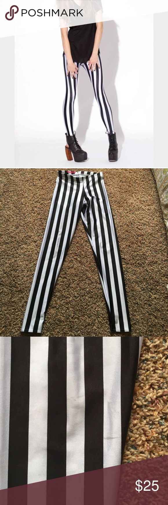 Blackmilk Beetlejuice Leggings Blackmilk beetlejuice leggings, size medium. Previously loved with some small spots to prove it, shown in pictures. A few little spots of the knees and a little one on the butt. Hardly noticeable in person! Price reflects flaws. No rips or tears! Blackmilk Pants Leggings