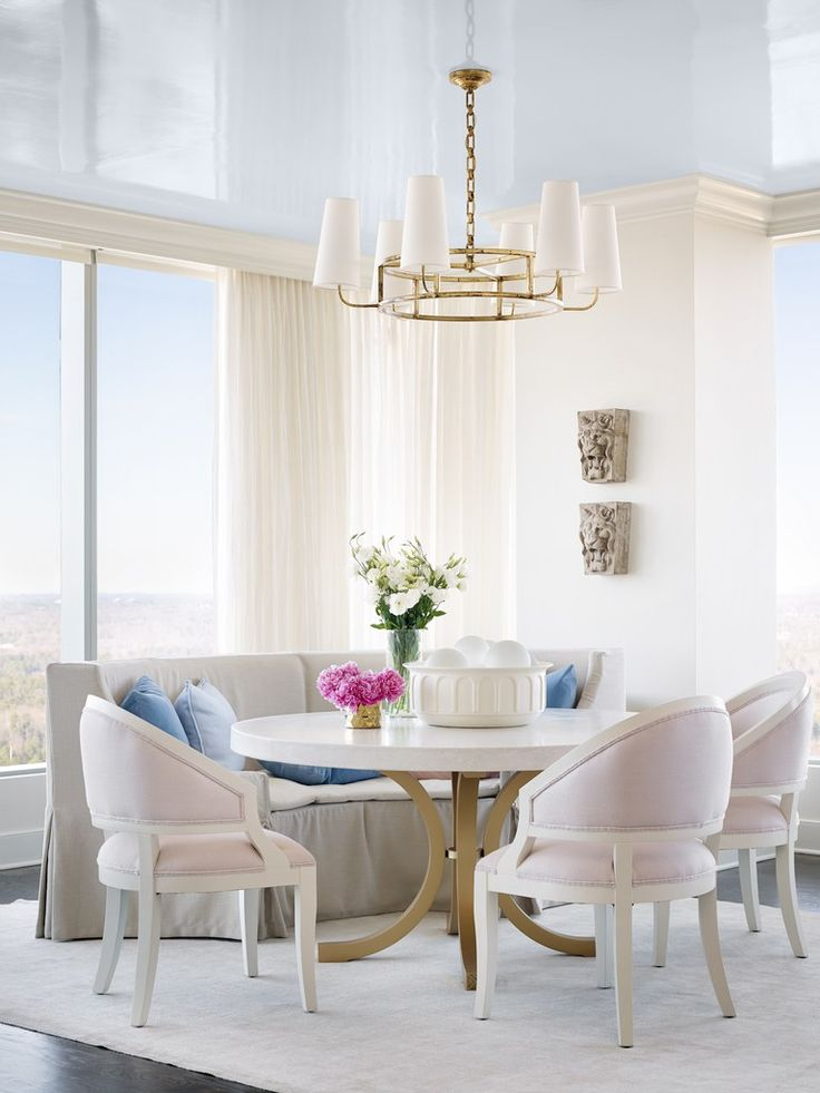 The glossy Borrowed Light ceiling in this dining room reflects the blue skies outside | archdigest.com