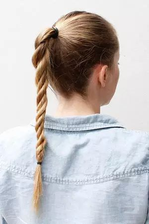 Add a personal twist to the low ponytail trend with an infinity braid. The look is fresh, easy, and totally boho-chic.