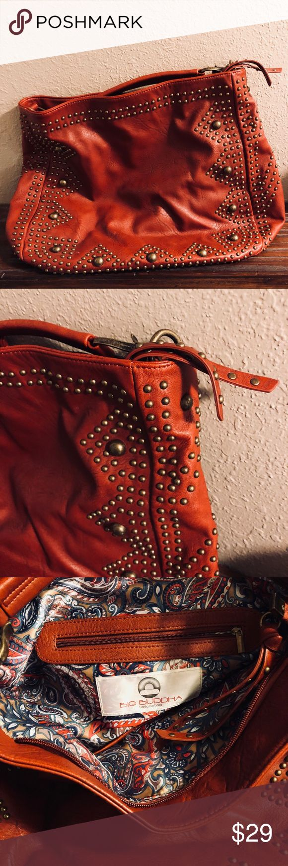 Big Buddha Rusty Red Satchel with Studded front The richest rusty red color! Big Buddha brand. Brassy stud detail. This is definitely a larger bag. Great as a carryon. See photos for texture details. Big Buddha Bags Hobos