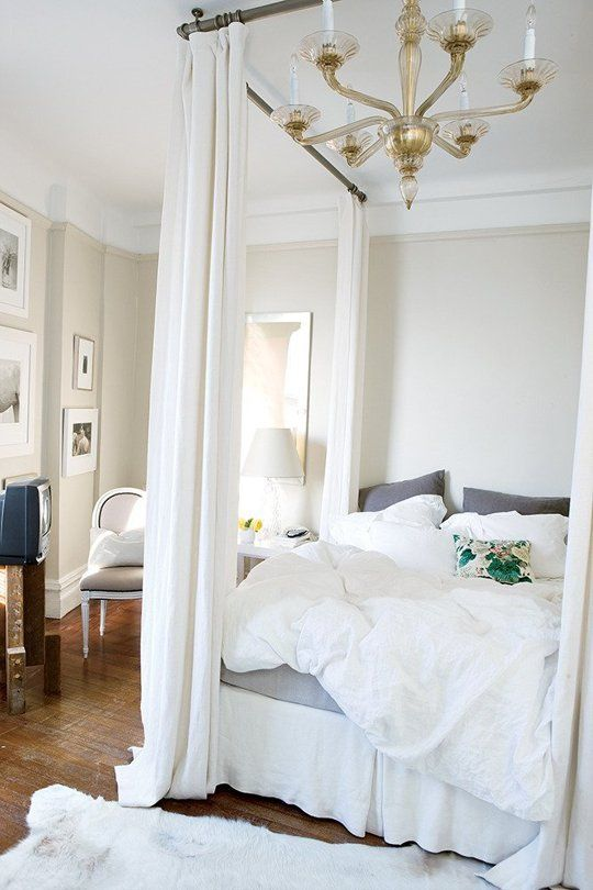 From Beginner to Advanced: 10 Steps to a Better Bedroom. Big, fluffy white bedding and colored sheets.